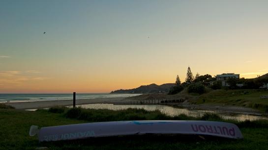 surf boat sunset