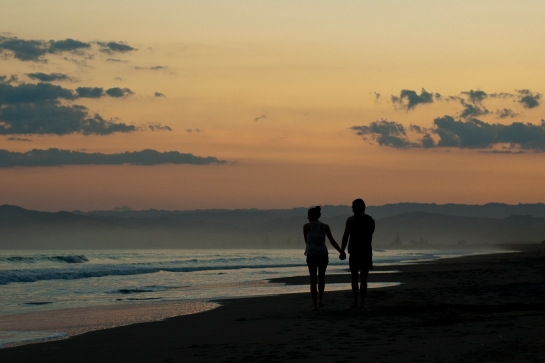 couple walking the beach